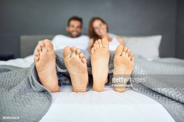 sunday is bed day - male feet soles stock photos and pictures