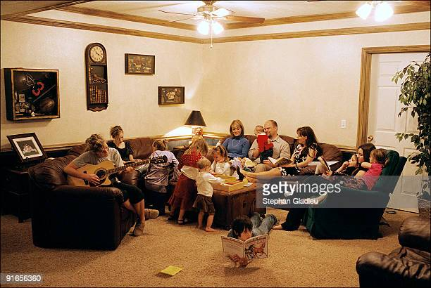 Sunday is family time for this polygamist family consisting of one father, three mothers and 21 children. The basement of the house they share in the...