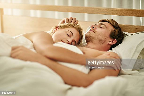 sunday is snuggle day - young couples stock pictures, royalty-free photos & images