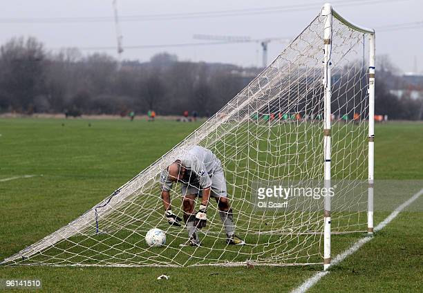 Sunday League goalkeeper retrieves the ball from the back of his net on the Hackney Marshes pitches on January 24, 2010 in London, England. Hackney...