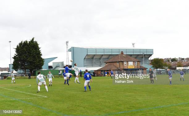 Sunday League team plays football behind Preton Park Stadium before the FA Women's Super League match between Liverpool and Reading at Prenton Park...