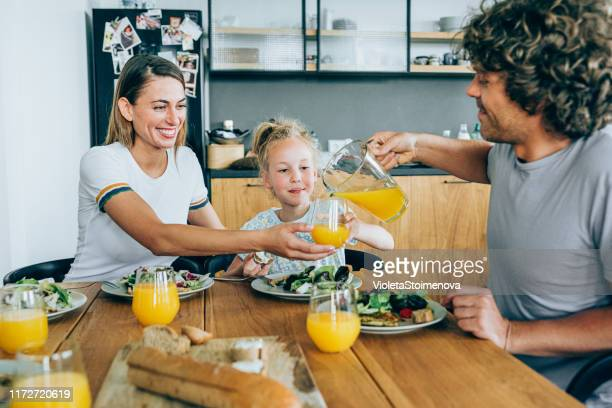 sunday lunch with her nearest and dearest - orange juice stock pictures, royalty-free photos & images