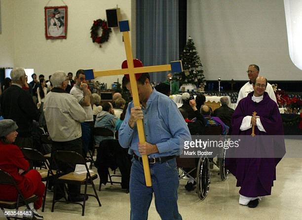 –Sunday Mass takes on a special meaning at the Fairview Developmental Center in Costa Mesa with Catholic Priest Philip Smith leading his congregation...