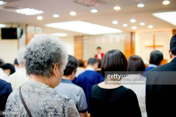 sunday morning services at the presbyterian church in taiwan - religious service stock pictures, royalty-free photos & images
