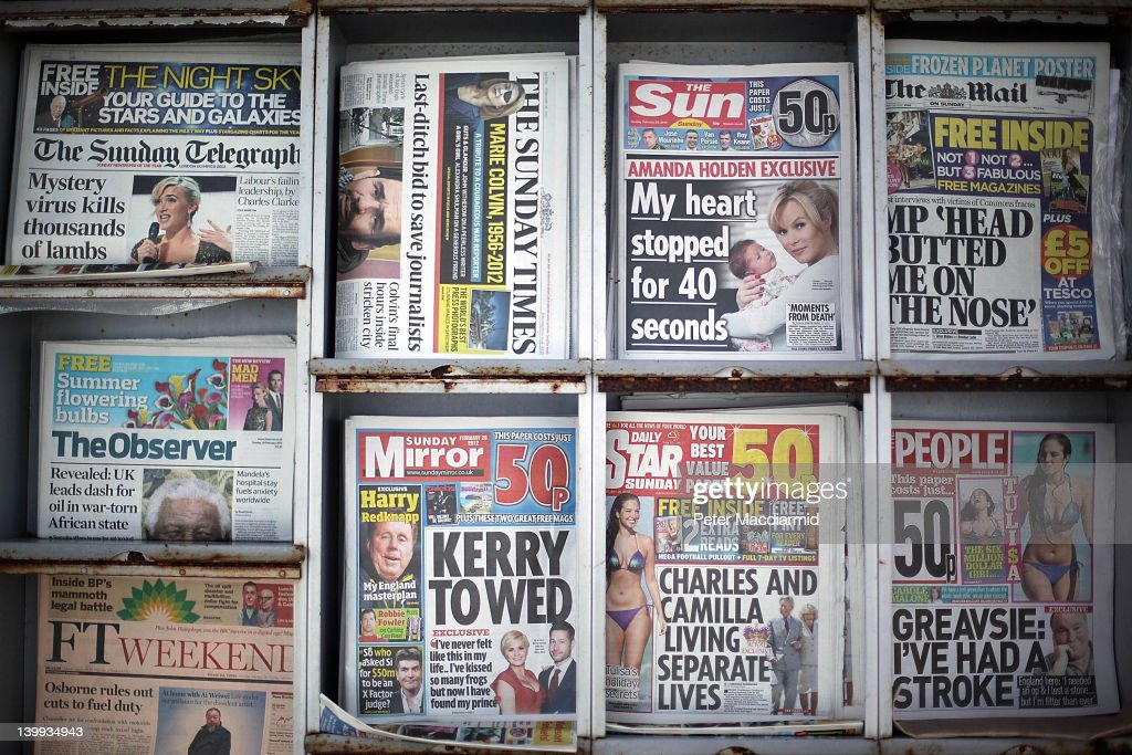 Sunday newspapers, including the first ever edition of The Sun on Sunday, are displayed for sale outside a convenience store on February 26, 2012 in Leatherhead, England. Rupert Murdoch's News International closed the News of The World Sunday tabloid newspaper in 2011 after revelations of phone hacking and it's new Sunday newspaper was launched today with an initial print run of three million copies.