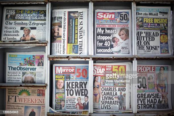 Sunday newspapers including the first ever edition of The Sun on Sunday are displayed for sale outside a convenience store on February 26 2012 in...