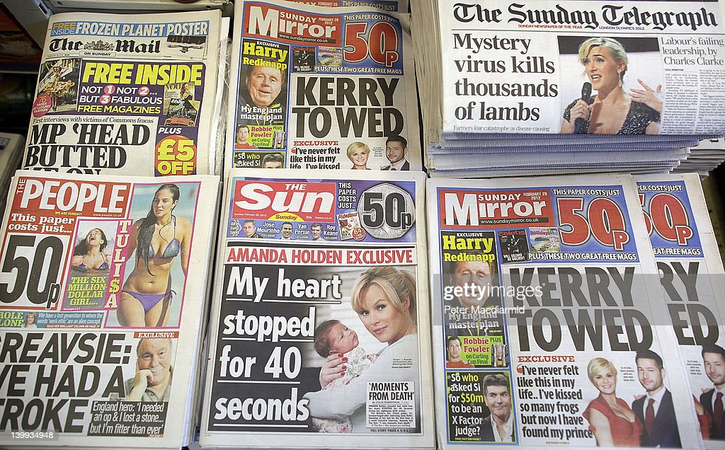 Sunday newspapers, including the first ever edition of The Sun on Sunday newspaper, are displayed for sale in a convenience store on February 26, 2012 in Leatherhead, England. Rupert Murdoch's News International closed the News of The World Sunday tabloid newspaper in 2011 after revelations of phone hacking and it's new Sunday newspaper was launched today with an initial print run of three million copies.