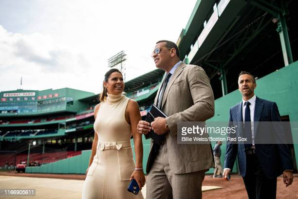 Sunday Night Baseball color commentators Jessica Mendoza Alex Rodriguez and Matt Vasgersian walk toward the Green Monster before a game between the...