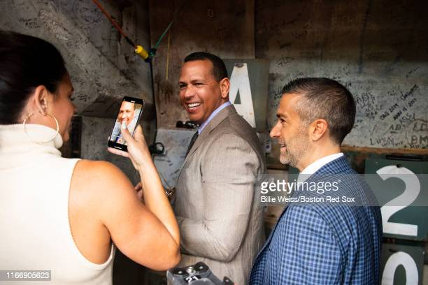 Sunday Night Baseball color commentators Jessica Mendoza Alex Rodriguez and Matt Vasgersian visit inside the Green Monster before a game between the...