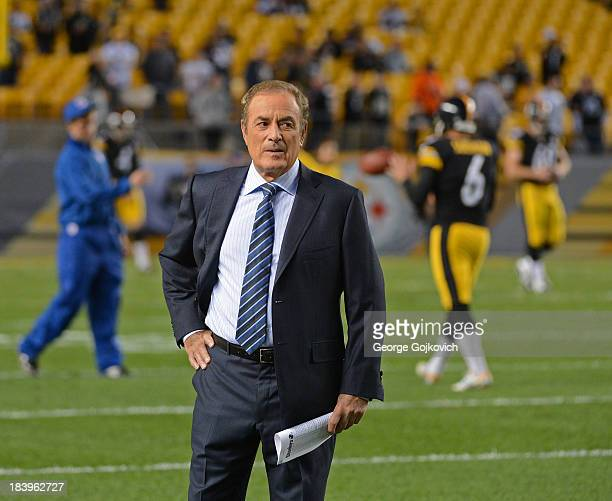 Sunday Night Football announcer Al Michaels looks on from the field before a game between the Chicago Bears and Pittsburgh Steelers at Heinz Field on...