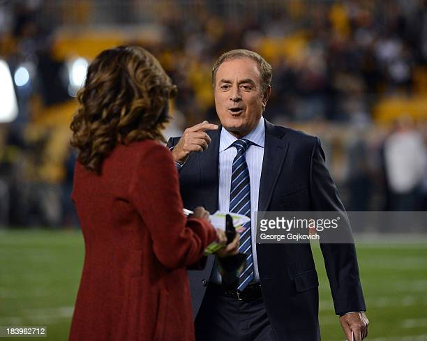 Sunday Night Football announcer Al Michaels talks to sideline reporter Michele Tafoya before a game between the Chicago Bears and Pittsburgh Steelers...