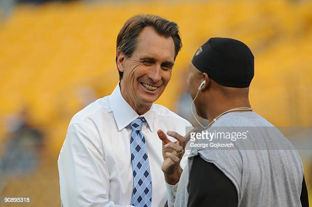 Sunday Night Football announcer Cris Collinsworth talks with wide receiver Hines Ward of the Pittsburgh Steelers before a game against the Tennessee...
