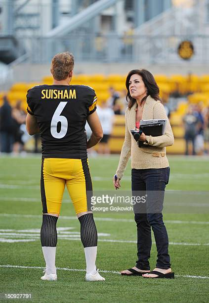 Sunday Night Football sideline reporter Michele Tafoya talks with kicker Shaun Suisham of the Pittsburgh Steelers before a preseason game against the...