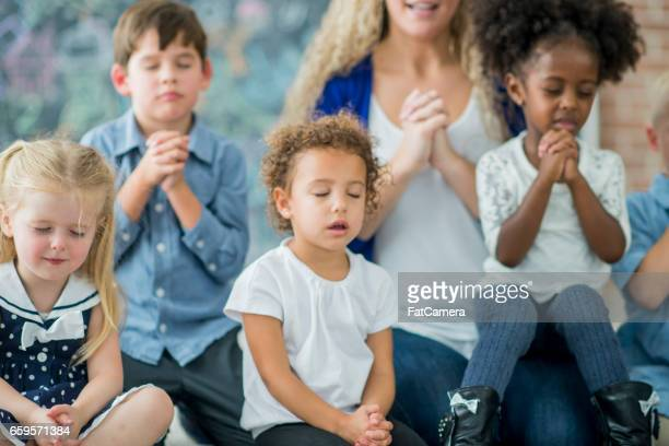 sunday school prayer - praying stock pictures, royalty-free photos & images