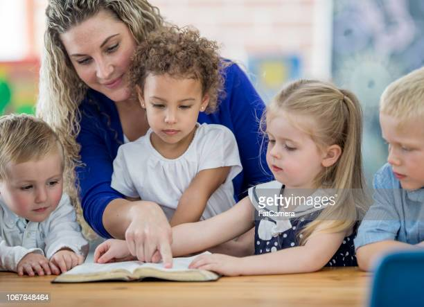 sunday school teacher and pupils - preschool age stock pictures, royalty-free photos & images