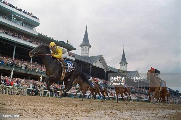 Sunday Silence wins the Kentucky Derby Easy Goer was second and Awe Inspiring was third