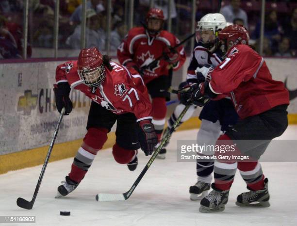 Sunday_04/08/01_Mpls Canada's Cassie Campbell and Geraldine Heaney kept the puck away from Team USA's Jenny Schmidgall DAVID BREWSTER photo