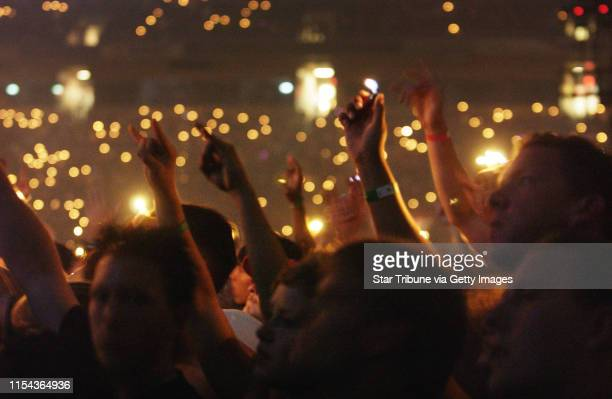 SUNDAY_07/27/03_Mpls Fans celebrated the beginning of the Metallica concert by flicking their lighters