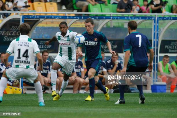 Sunderland AFC of England and FC Groningen of Netherland players compete for the ball during the Peace Cup 2012 Suwon semi final round in the Suwon...