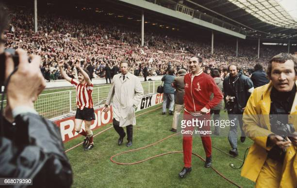 Sunderland captain Bobby Kerr and manager Bob Stokoe celebrate after their 10 victory over Leeds United in the 1973 FA Cup Final also pictured is...