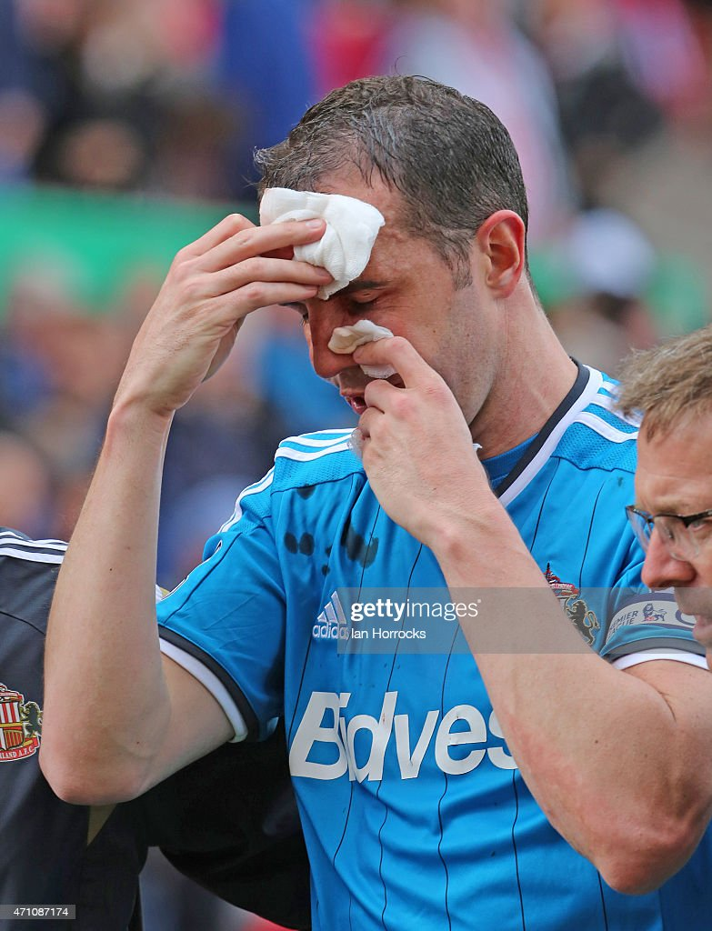 Sunderland captain John O'Shea goes off injured during the Barclays Premier League match between Stoke City and Sunderland AFC at the Britannia Stadium on April 25, 2015 in Stoke, England.