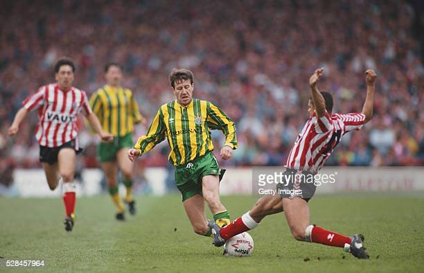 Sunderland defender Rueben Agboola lunges at Kevin Brock of Newcastle United during a League Division Two play off semi final match between...