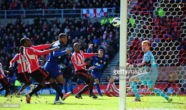 Sunderland defender Titus Bramble deflects Robin Van Persie's shot into his own net for the winning goal during the Barclays Premier League match...