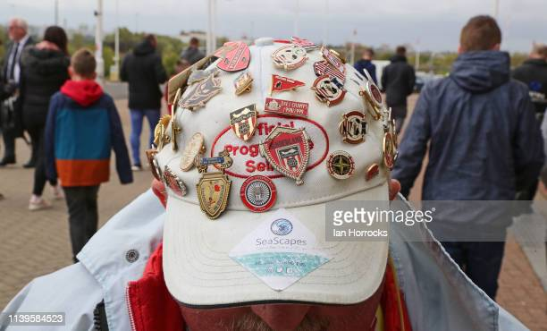 Sunderland fan shows his cap badges before the Sky Bet League One match between Sunderland and Portsmouth at Stadium of Light on April 27 2019 in...