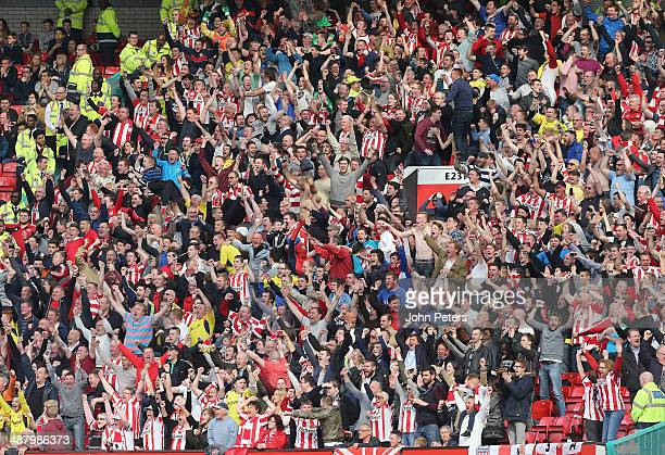 Sunderland fans celebrate after the Barclays Premier League match between Manchester United and Sunderland at Old Trafford on May 3, 2014 in...