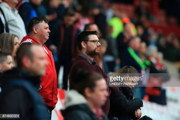 Sunderland fans watch their team lose during the English Premier League football match between Sunderland and Bournemouth at the Stadium of Light in...