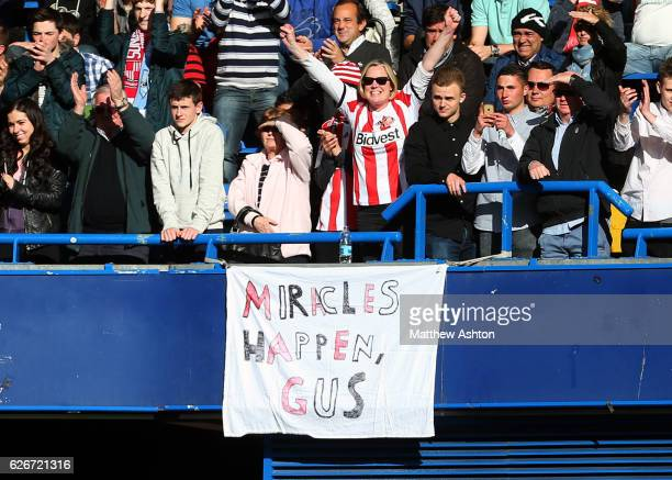 Sunderland fans with a banner saying - MIRACLES HAPPEN GUS - as they support their team as they battle relegation