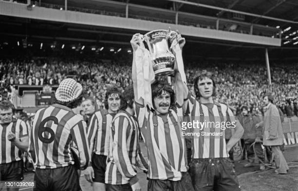 Sunderland FC captain Bobby Kerr holds up the trophy after his team won the FA Cup Final against Leeds United at Wembley Stadium in London, with a...