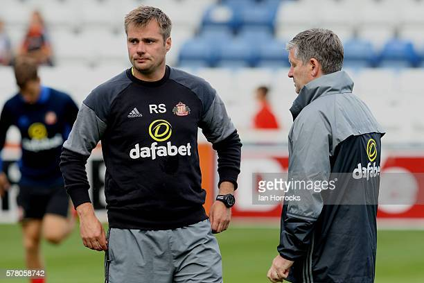 Sunderland first team coach Robbie Stockdale and Assistant manager Paul Bracewell chat before the preseason friendly match between Sunderland AFC and...