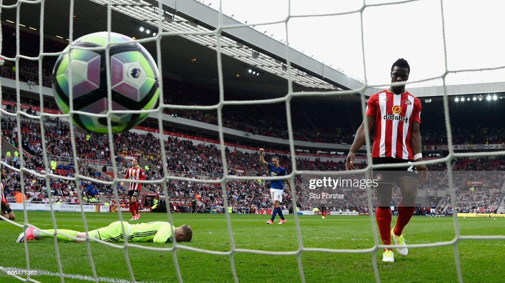 Sunderland goalkeeper Jordan Pickford reacts as Manchester United striker Zlatan Ibrahimovic (2nd r) celebrates the 3rd United goal during the Premier League match between Sunderland and Manchester United at Stadium of Light on April 9, 2017 in Sunderland, England.