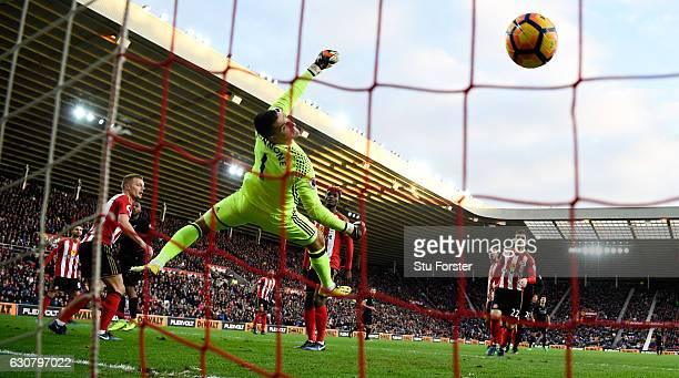 Sunderland goalkeeper Vito Mannone is beaten by a header from Liverpool player Daniel Sturridge for the opening Liverpool goal during the Premier...