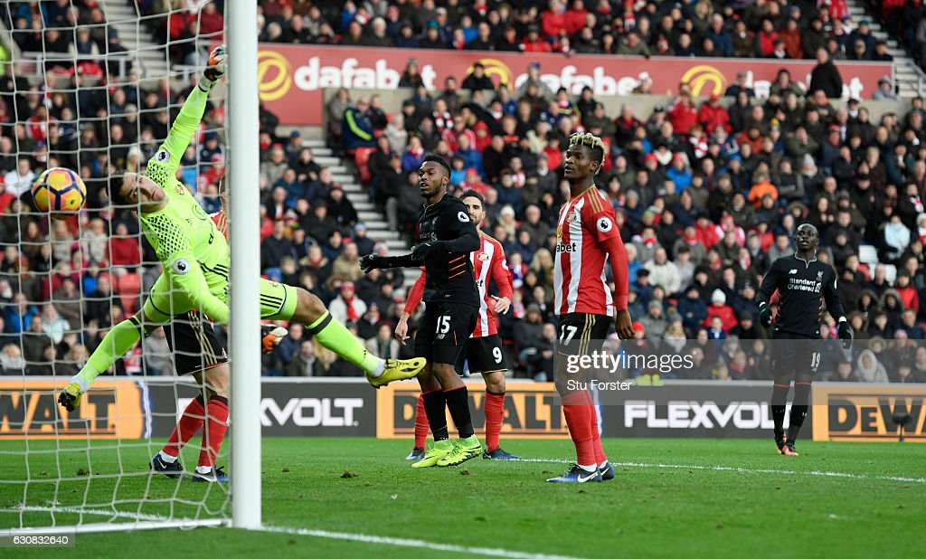 Sunderland goalkeeper Vito Mannone is beaten by a header from Liverpool player Daniel Sturridge (c) for the opening Liverpool goal during the Premier League match between Sunderland and Liverpool at Stadium of Light on January 2, 2017 in Sunderland, England.