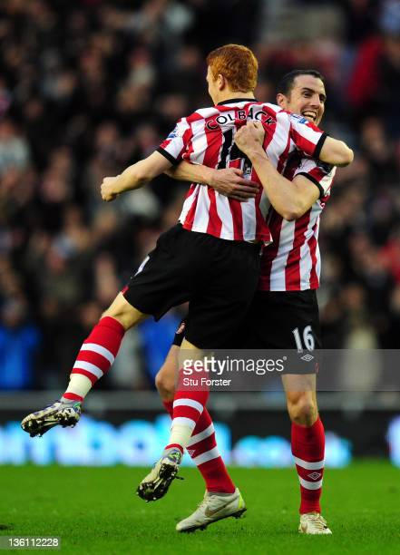 Sunderland goalscorer Jack Colback is congratulated by John O'Shea during the Barclays Premier League match between Sunderland and Everton at Stadium...