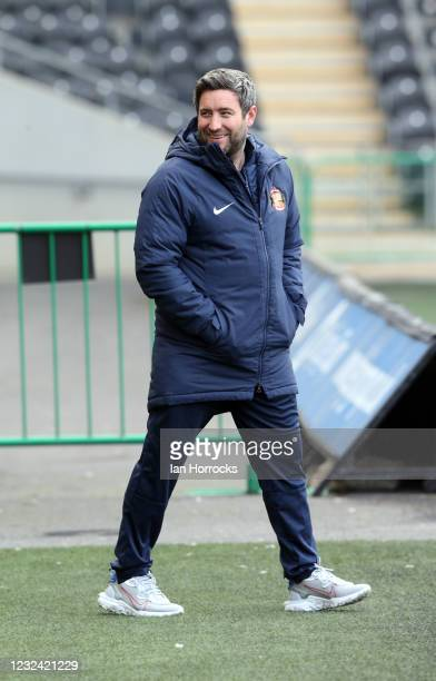 Sunderland head coach Lee Johnson walks on the pitch before the Sky Bet League One match between Hull City and Sunderland at the Kcom Stadium on...