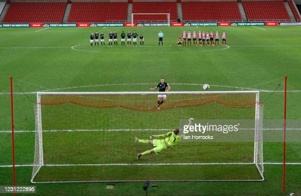 Sunderland keeper Lee Burge makes the save to take them through to the final during the Papa John's Trophy semi-final between Sunderland AFC and...