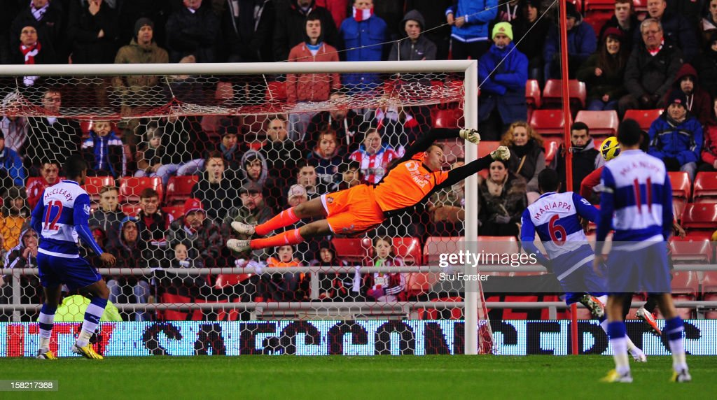 Sunderland keeper Simon Mignolet produces a diving stop during the Barclays Premier League match between Sunderland and Reading at Stadium of Light on December 11, 2012 in Sunderland, England.