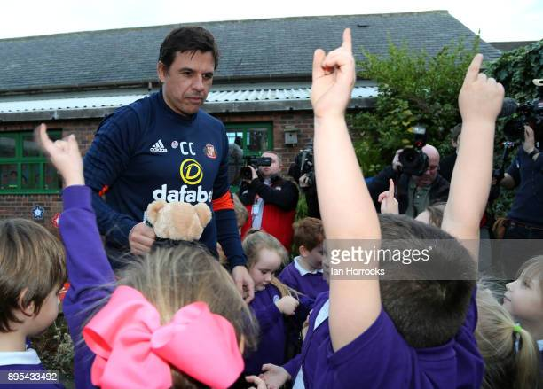Sunderland manager Chris Coleman gives out goody bags to kids during a visit to Blackhall Primary School on December 19 2017 in Hartlepool England