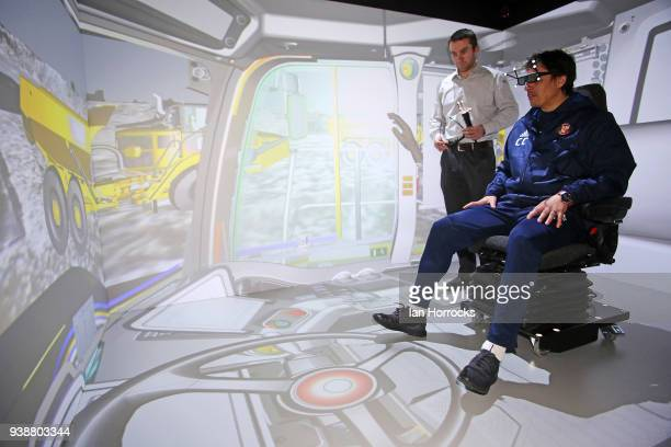 Sunderland manager Chris Coleman practices on a truck driving simulator during a visit to the Caterpillar factory in Peterlee Sunderland on March 27...