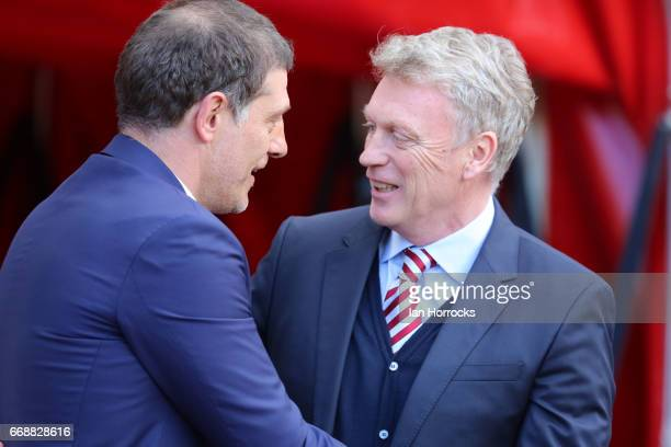 Sunderland manager David Moyes greets West Ham manager Slaven Bilic during the Premier League match between Sunderland and West Ham United at Stadium...