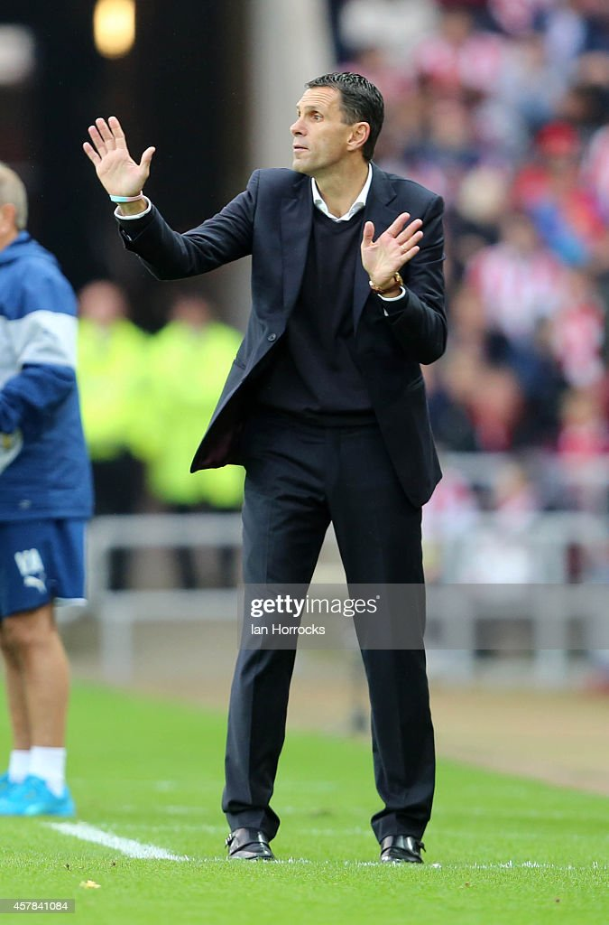 Sunderland manager Gus Poyet gestures during the Barclays Premier League match between Sunderland AFC and Arsenal FC at The Stadium of Light on October 25, 2014 in Sunderland, England.