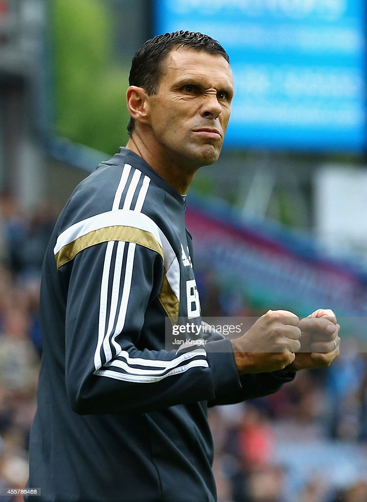 Sunderland Manager Gus Poyet gestures to the fans during the Barclays Premier League match between Burnley and Sunderland at Turf Moor on September 20, 2014 in Burnley, England.