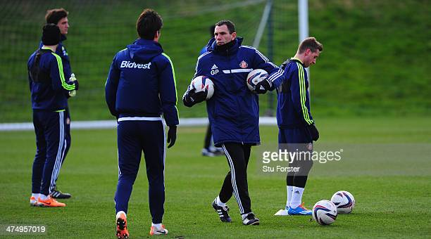 Sunderland manager Gus Poyet looks on during Sunderland training ahead of sunday's Capital One Cup Final against Manchester City at the Academy of...