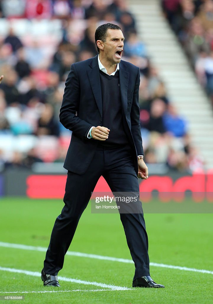 Sunderland manager Gus Poyet reacts during the Barclays Premier League match between Sunderland AFC and Arsenal FC at The Stadium of Light on October 25, 2014 in Sunderland, England.