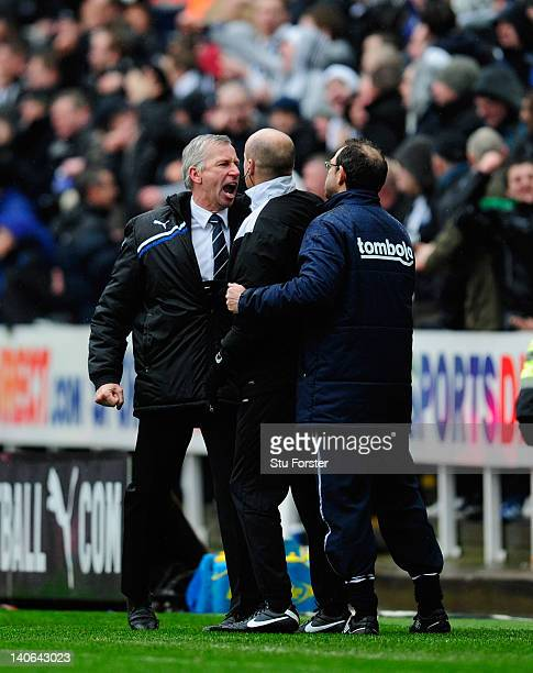 Sunderland manager Martin O' Neill is kept apart from Newcastle mananger Alan Pardew by 4th official Lee Mason during the Barclays Premier League...