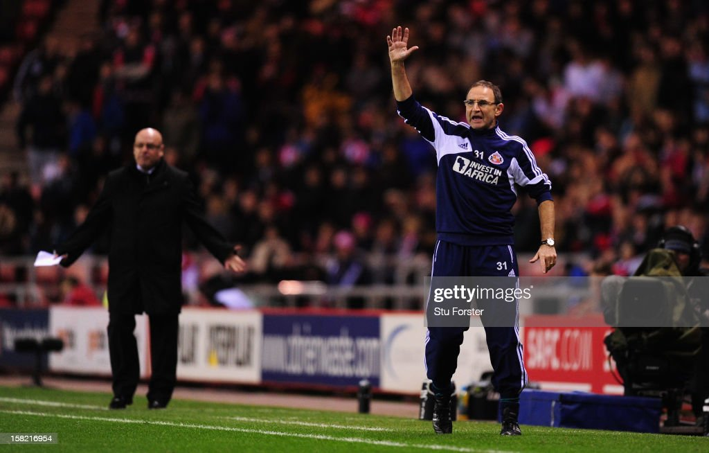 Sunderland manager Martin O' Neill (r) reacts as Reading manager Brian McDermott (l) looks on during the Premier League match between Sunderland and Reading at Stadium of Light on December 11, 2012 in Sunderland, England.