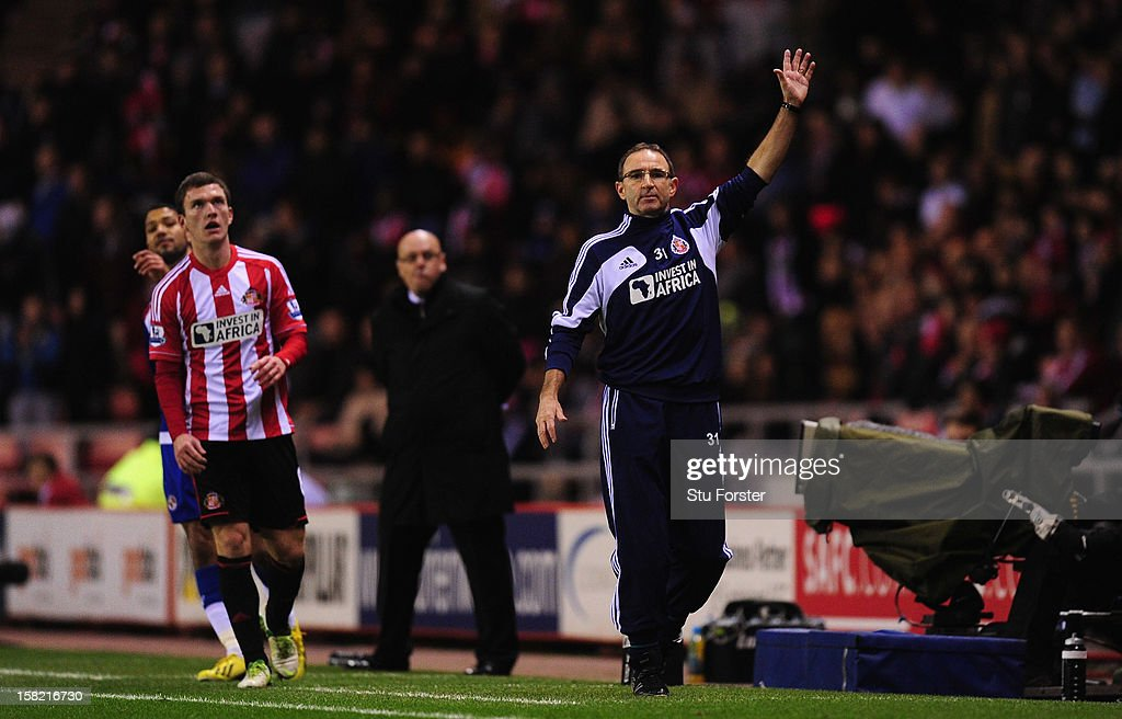 Sunderland manager Martin O' Neill (r) reacts during the Premier League match between Sunderland and Reading at Stadium of Light on December 11, 2012 in Sunderland, England.